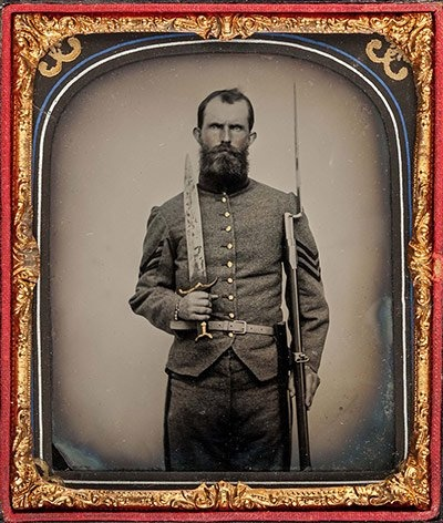 Confederate cavalry soldier with weapons.jpg