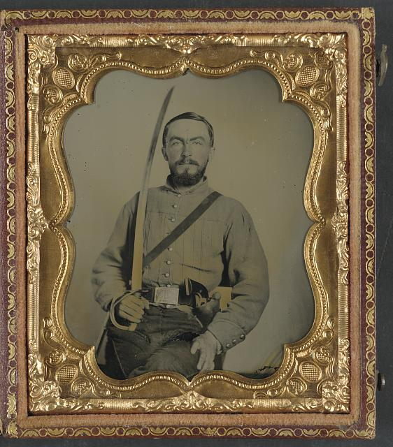 Confederate Cavalryman with revolver and saber.jpg
