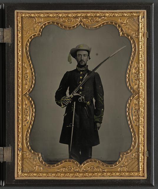 Confederate trooper with sword and revolver.jpg