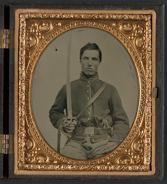 Union soldier with two revolvers and saber.jpg